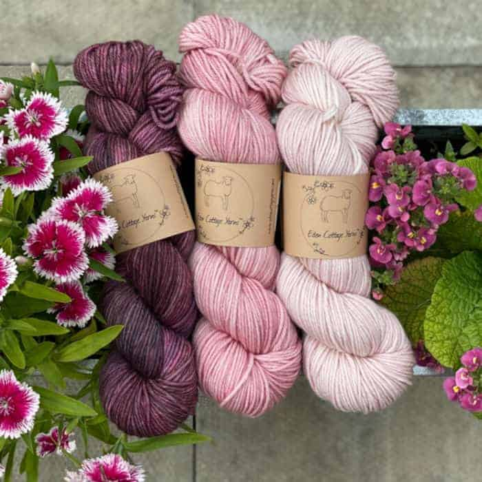A trio of dark to light pink yarn.