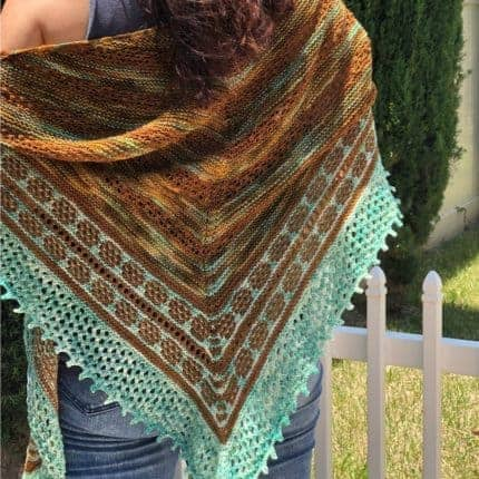 An amber and aqua triangular shawl.