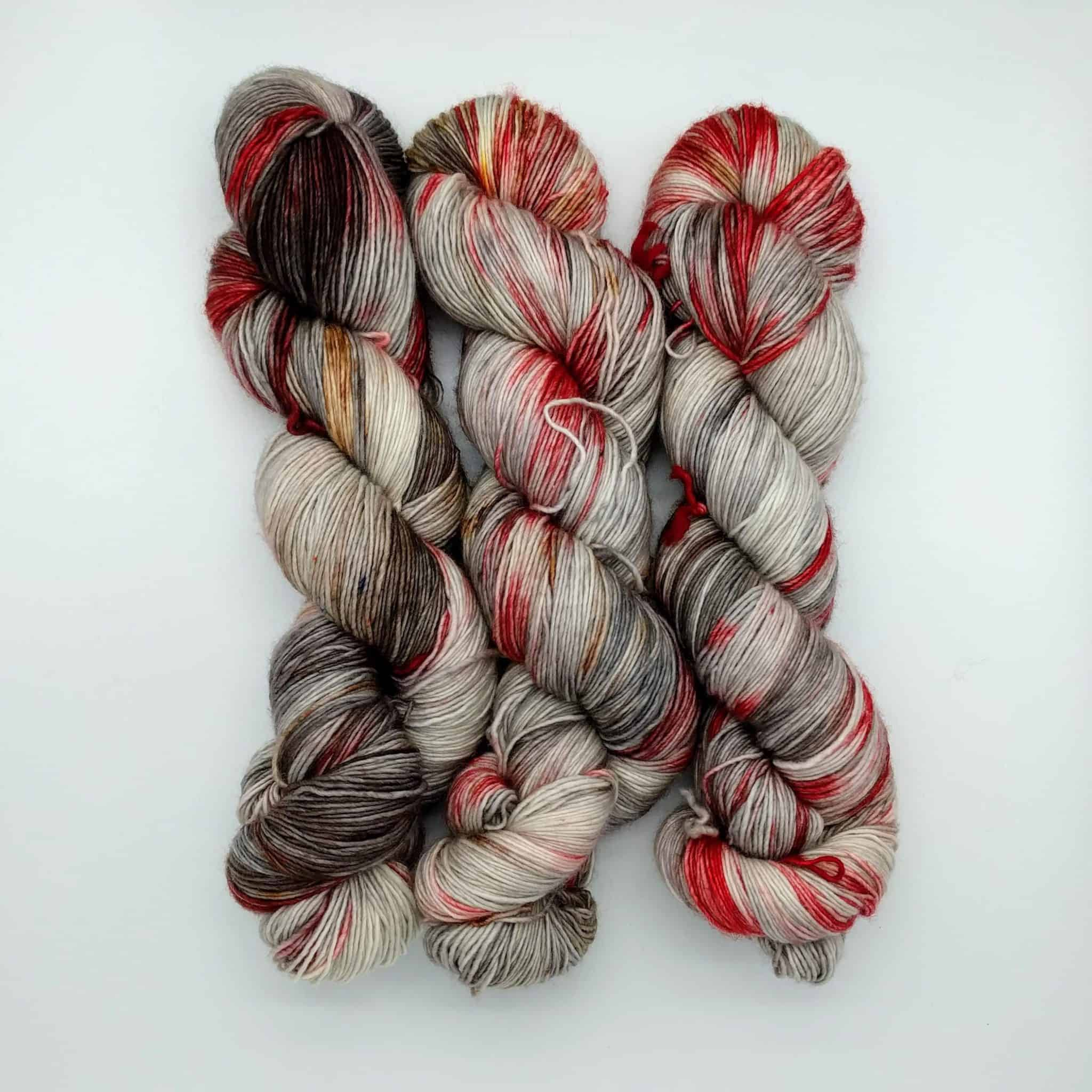 Red, black and gray yarn.