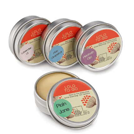 Silver tins with an orange and cream label.