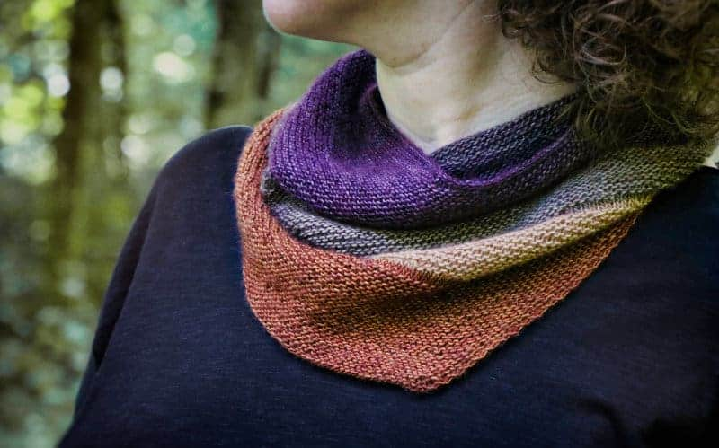 A cowl in purple and salmon colors.