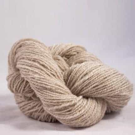 A twisted hank of rustic cream-colored yarn.