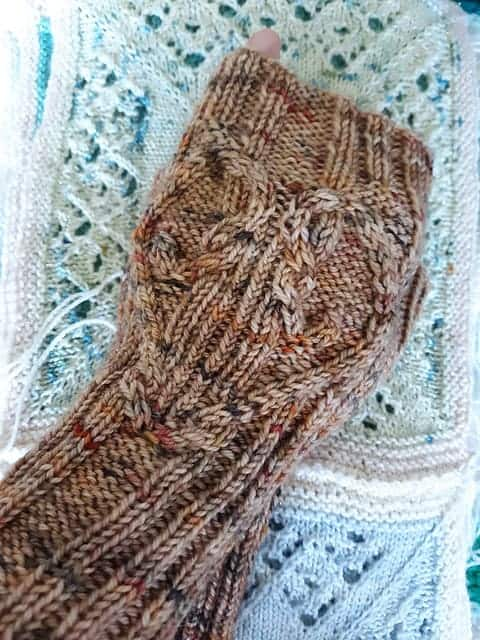 Brown fingerless mitts.