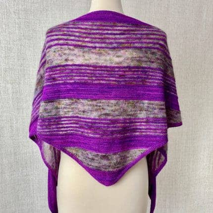 A purple and gray striped shawl sits on a dress form.