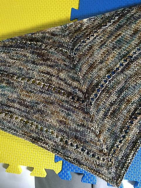 A gray speckled shawl.