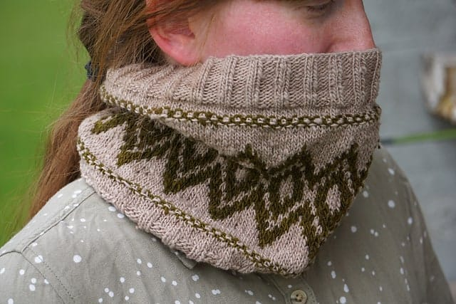 A beige cowl with brown colorwork diamonds.