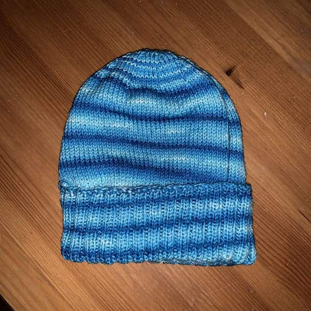 A bright blue striped hat.