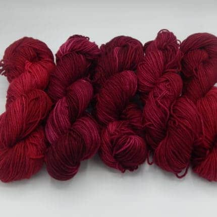 Skeins of dark red yarn.