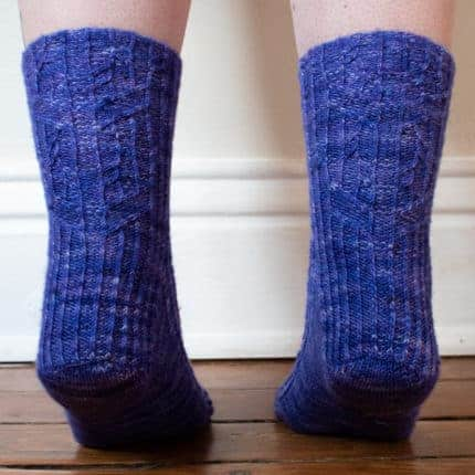 Purple cabled socks.