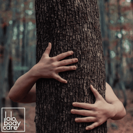A person hugging a tree.