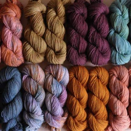 Two rows of pink, gold, purple, blue and orange yarn.