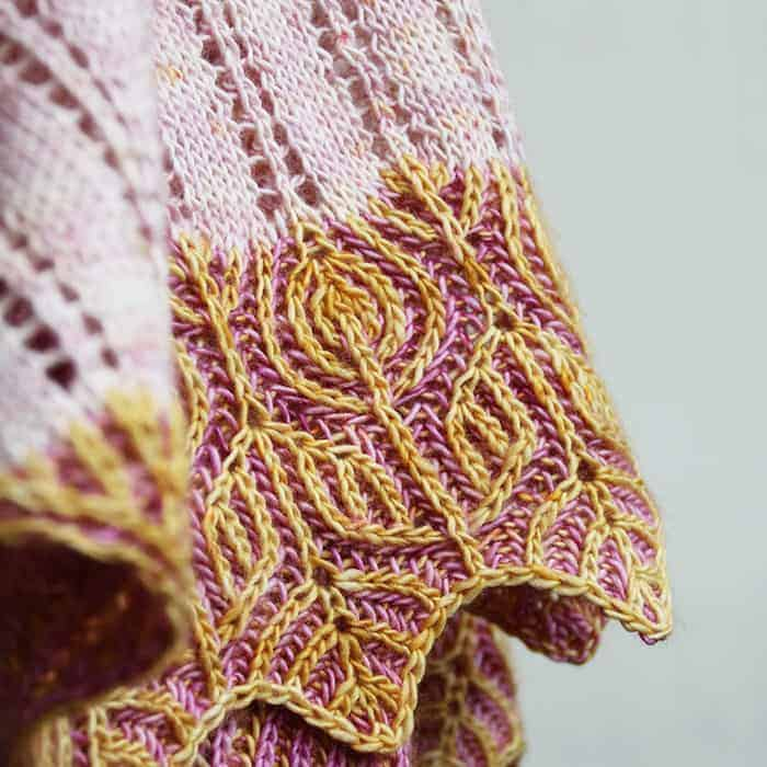 The edge of a pink and orange botanical brioche wrap.