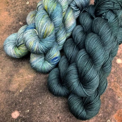 Teal and teal and green speckled yarn.