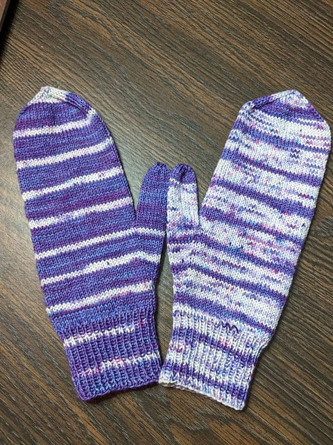 Purple striped mittens.