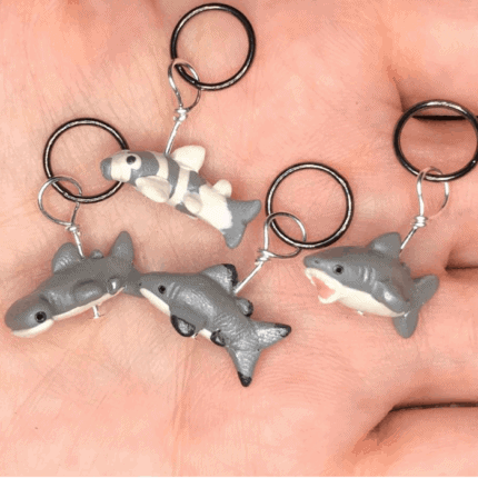 Gray shark stitch markers.