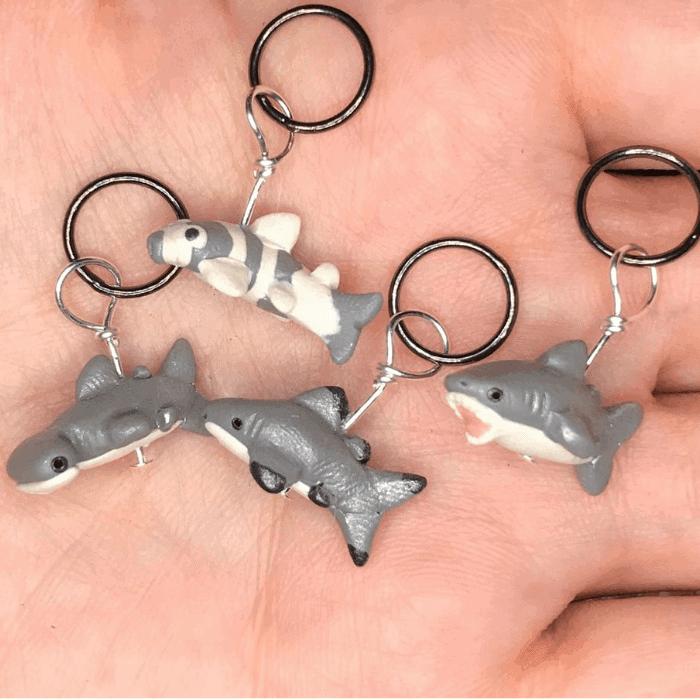 Gray shark stitch markers.