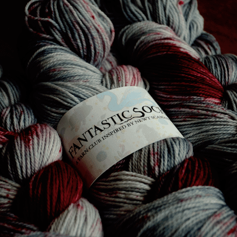 Red, blue and gray hand-dyed yarn.