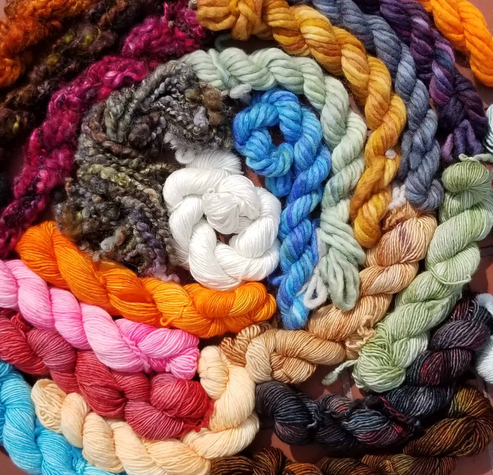 A spiral of brightly colored hanks of yarn.