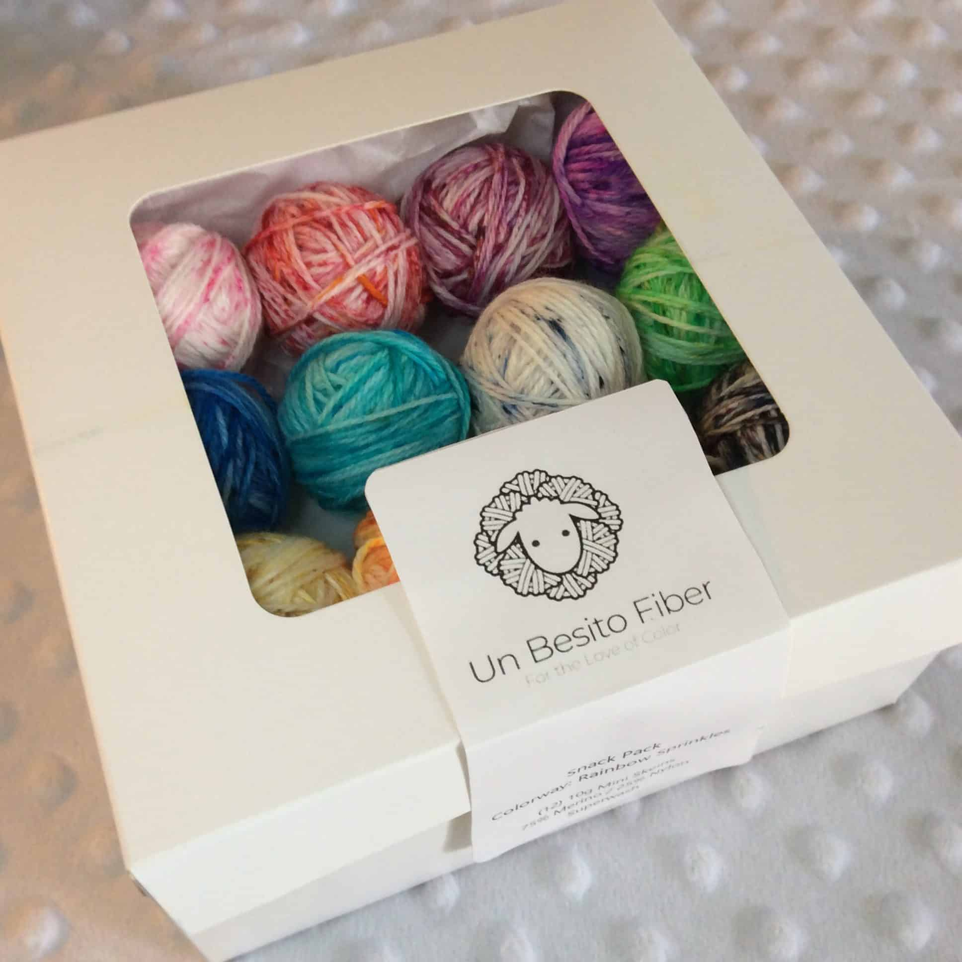 A bakery box with colorful yarn inside.