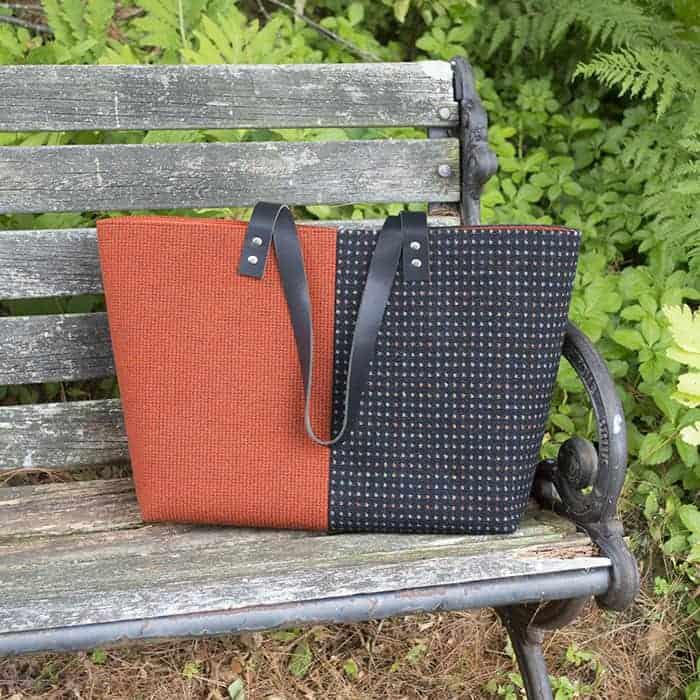 An orange and brown tweed tote bag.