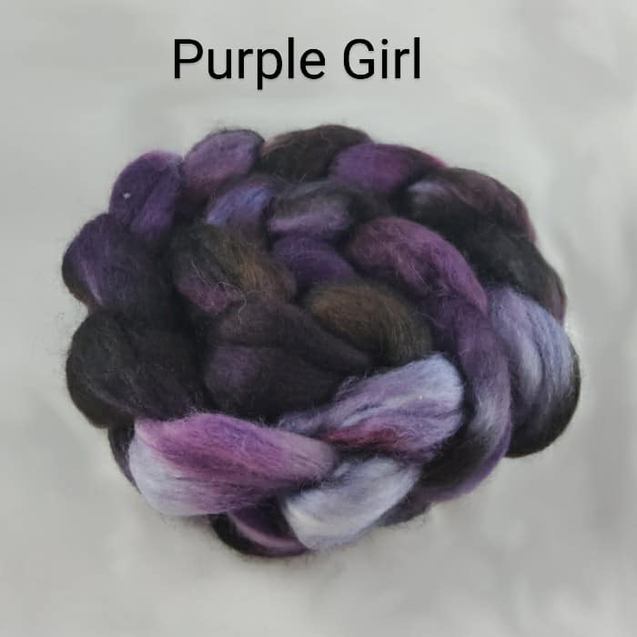 A braid of black and purple fiber and the words Purple Girl.