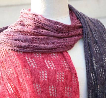 A pink to purple gradient lace scarf.