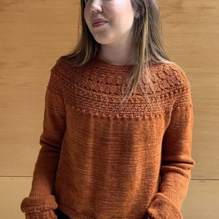 An orange sweater.