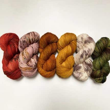 Yarn in red, brown and gold fall colors.