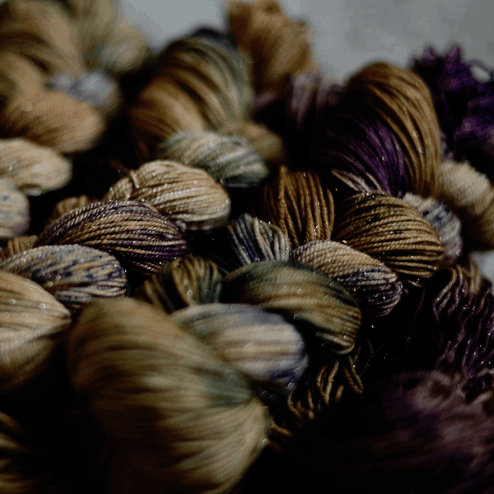 Dark brown and green dyed yarn.