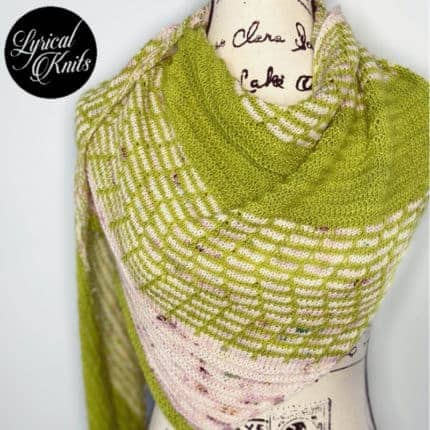 A moss green and dappled pink shawl.