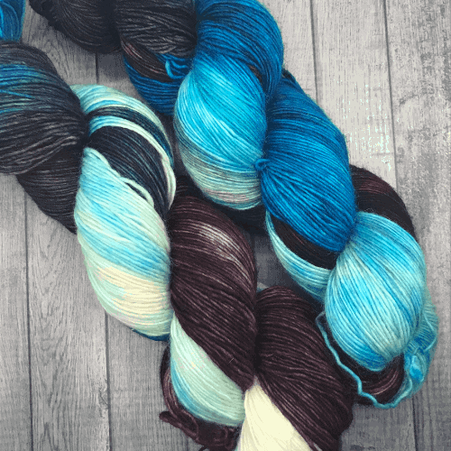 Blue and dark purple hand-dyed yarn.