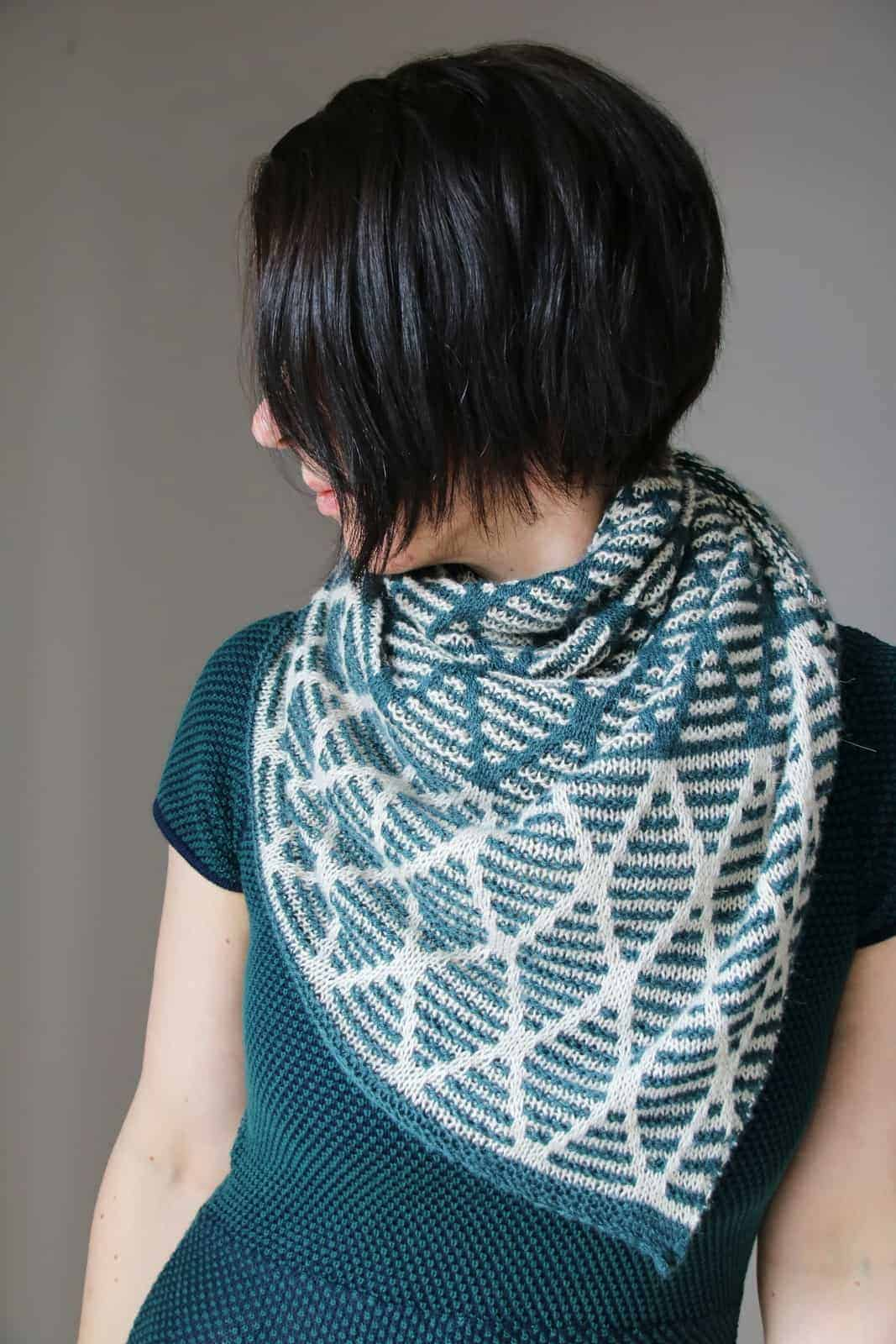 A green and white geometric shawl.