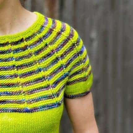 A chartreuse sweater with a striped yoke in blue and brown.