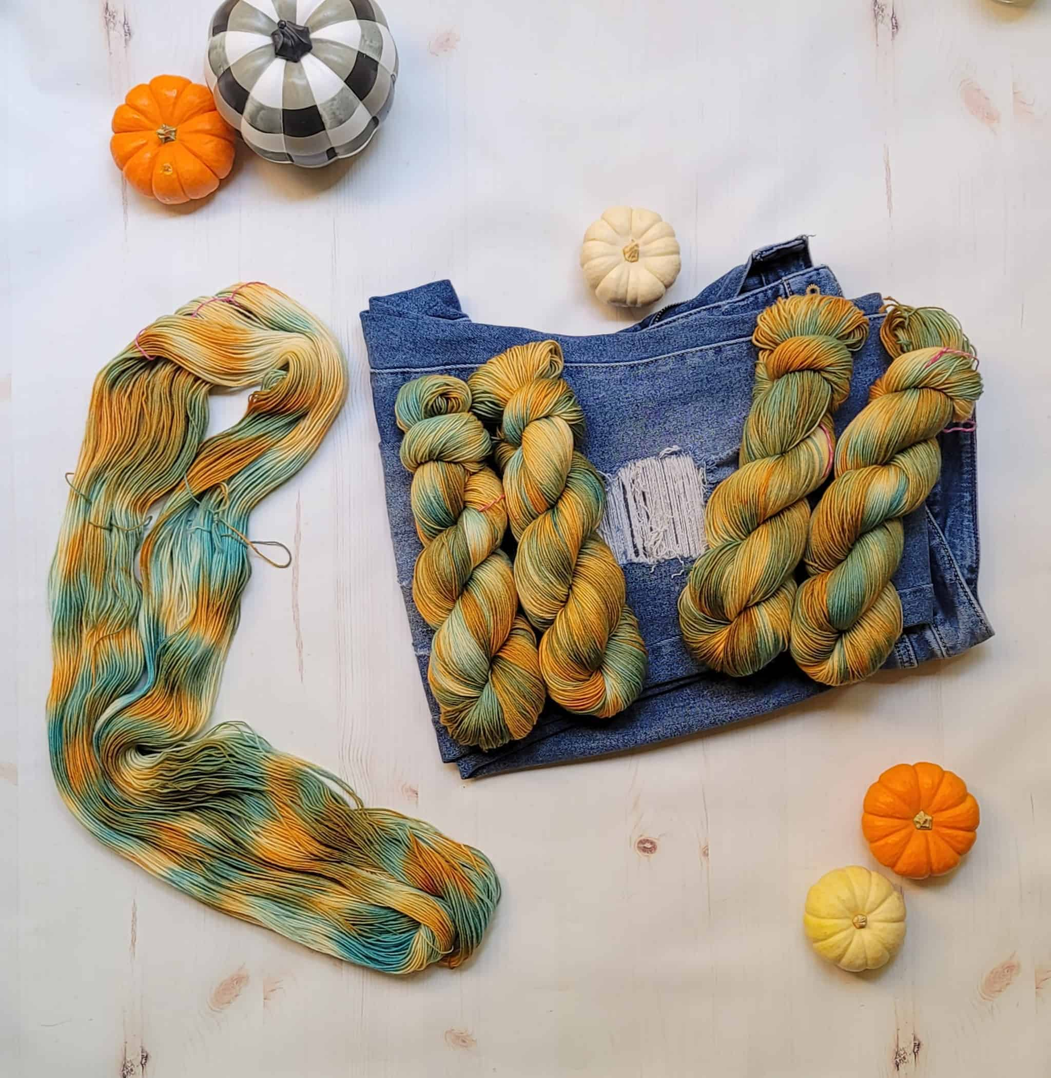 Gold and teal yarn.
