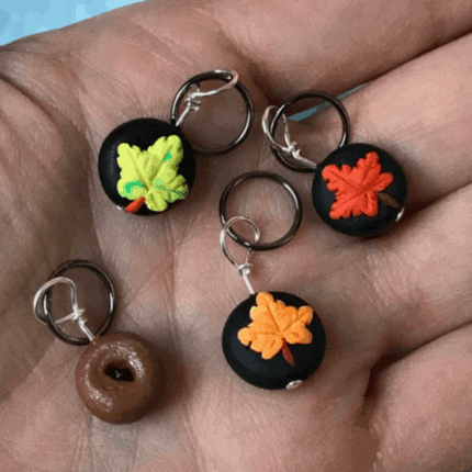 Charms with fall leaves and a doughnut.