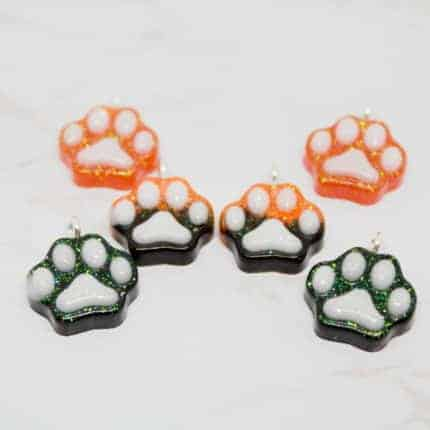 Orange and black paw charms.