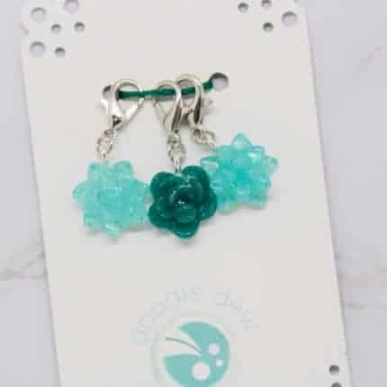 Aqua and green flower stitch markers.