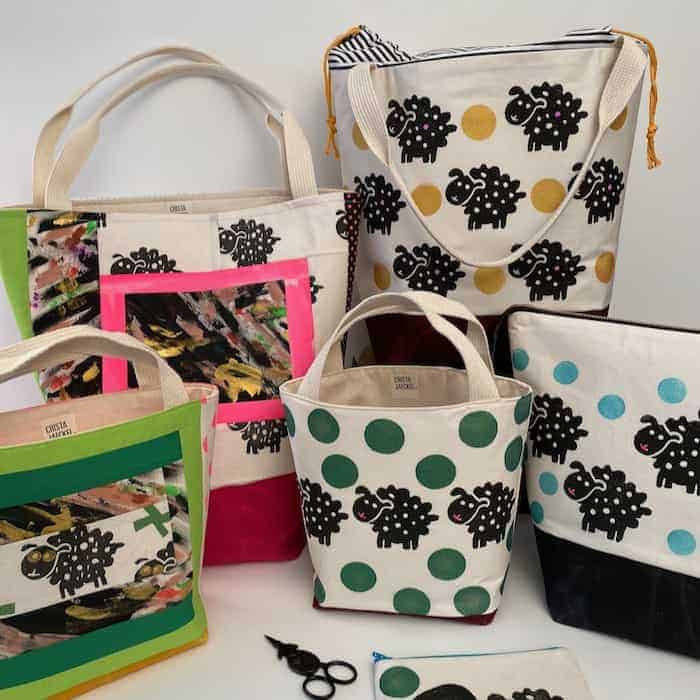 A collections of bags with sheep.