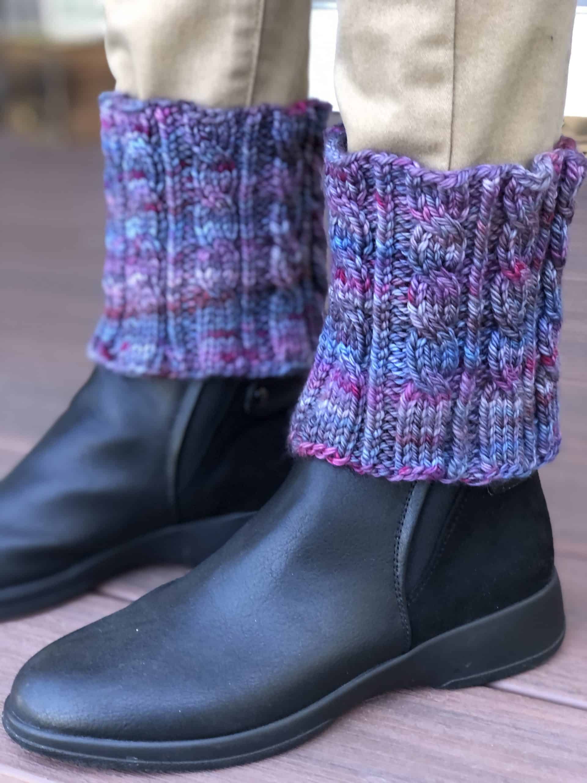 Boots with purple cabled cuffs.