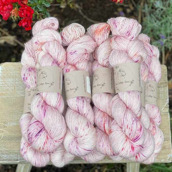 Pale pink speckled yarn.