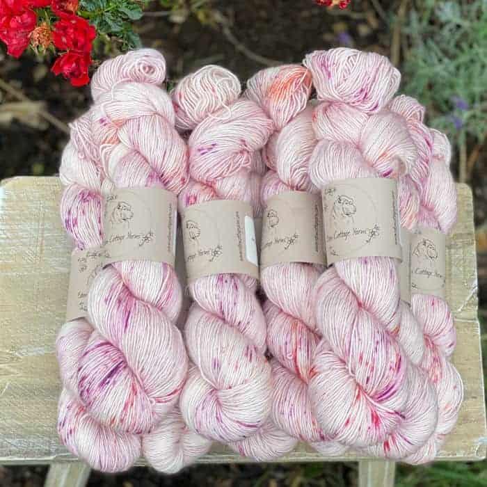 Pale pink speckled yarn.