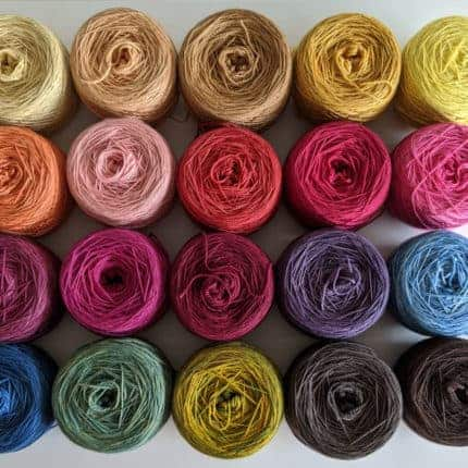 Rows of rainbow colored yarn.