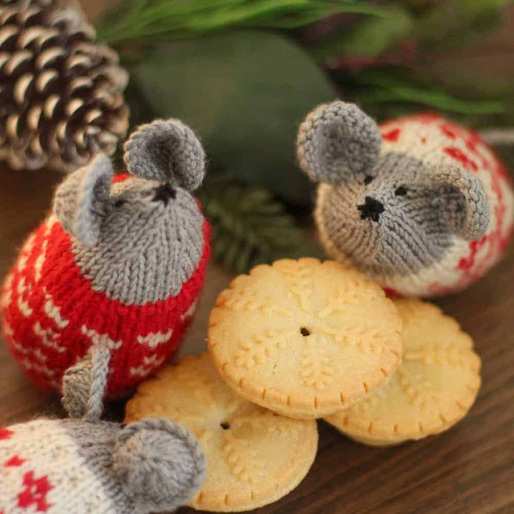 Knit gray mice in red and white sweaters.