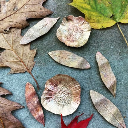 Leaves and leaf-shaped metal jewelry.