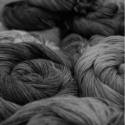 A black and white photo of yarn.