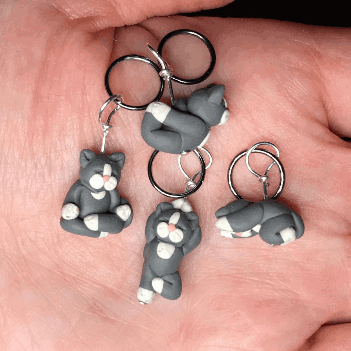 Gray cat stitch markers.