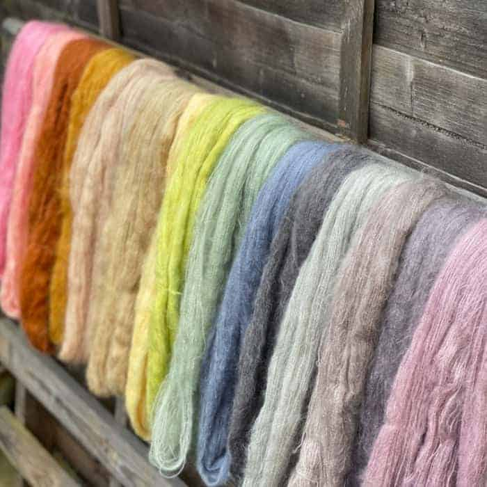 Hanging rainbow of yarn.