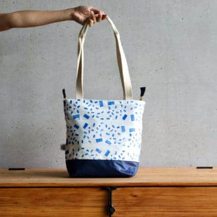 A blue and white patterned tote bag.