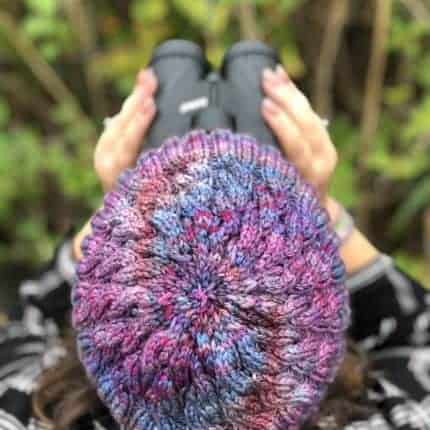 The top of a purple and blue knit hat.