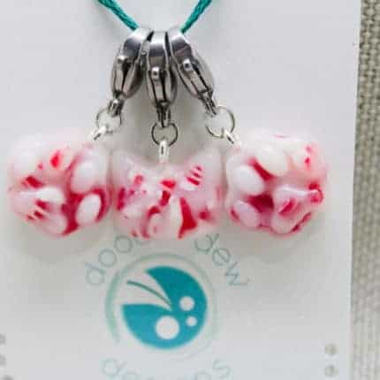 Stitch markers in red and white peppermint candy colors.